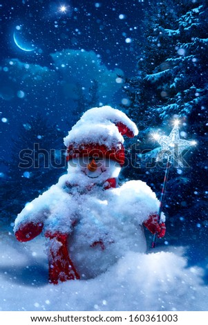 Art Christmas snowman and fir branches covered with snow