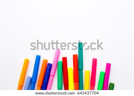 Art - colored pens on white background