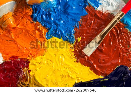 art concept with brush and oil paint as background - stock photo
