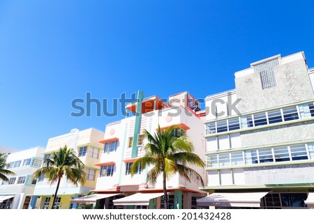 Art deco architecture of Miami Beach, Florida. Street with palms and colorful buildings. - stock photo