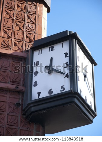 Art Deco clock on the side of an ornate building in Detroit Michigan. - stock photo