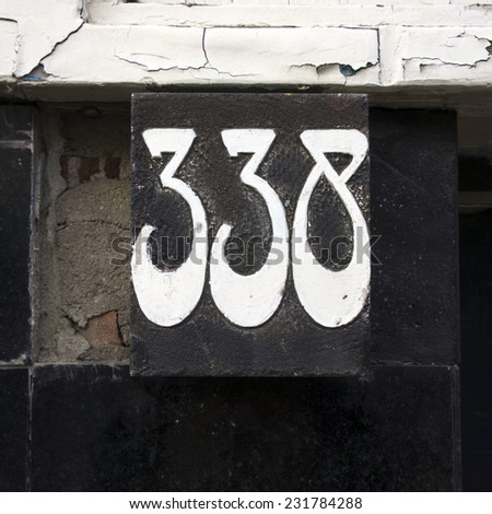 art deco house number three hundred and thirty eight sculptured in stone and painted - stock photo