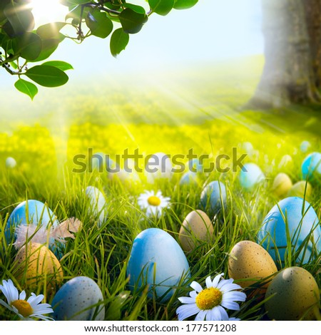 Art decorated easter eggs in the grass with daisies - stock photo