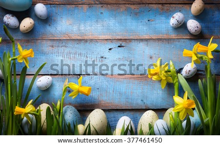 art easter Background with easter eggs and spring flowers - stock photo