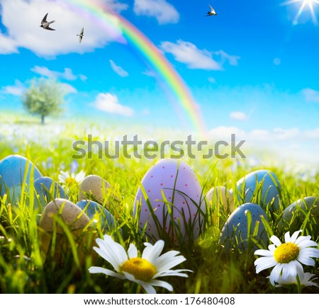 art easter eggs on spring field - stock photo