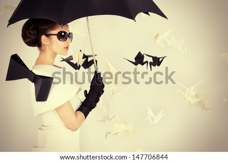 Art fashion photo of a gorgeous woman in paper dress. Black and white. - stock photo
