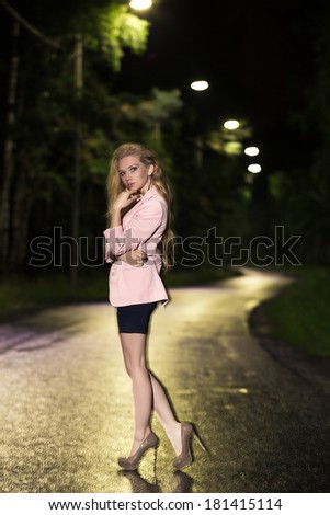 Art fashion portrait of young woman on a road - stock photo