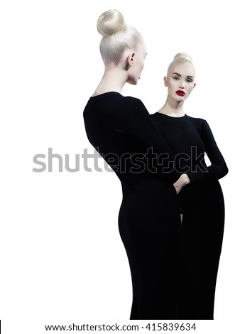 Art fashion studio portrait of elegant blonde and her reflection in the mirror - stock photo