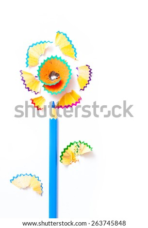 art flower from blue pencil and colored shavings on white background - stock photo