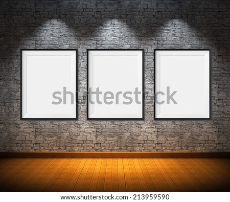 Art gallery. Blank picture frames on brick wall background. - stock photo