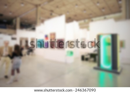 Art gallery generic background, location and humans not recognizable. Intentionally blurred background. - stock photo
