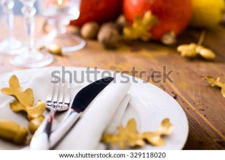 Art happy thanksgiving dinner; Autumn table setting with pumpkins - stock photo