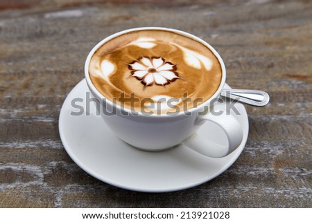 art latte coffee on white cup - stock photo