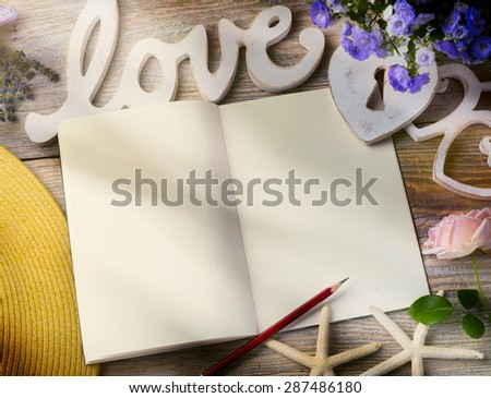 Art Love Background. Open book and White heart on wooden background. - stock photo