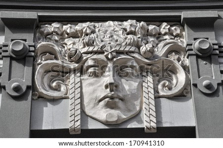 Art nouveau mask on the facade of municipal house in Riga, Latvia.