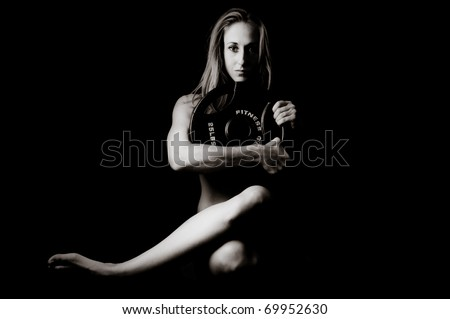 Art of a Woman holding a 25 Lb Weight - stock photo