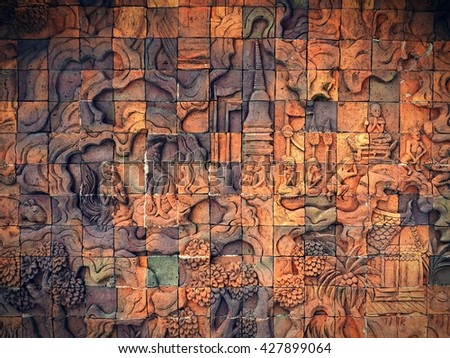Art on the stone about buddha story on temple wall - stock photo