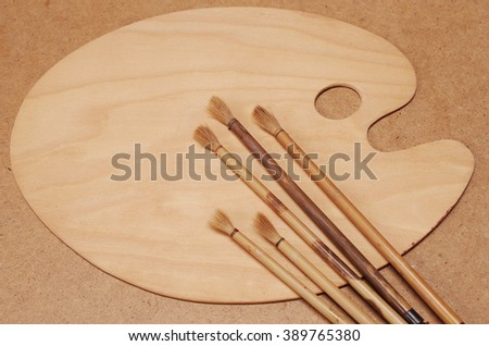 Art palette and paint brushes - stock photo