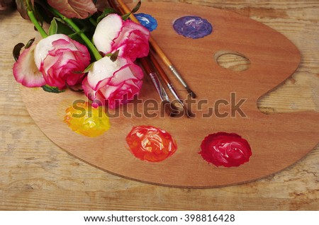 Art palette and three roses