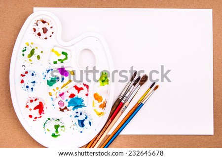 Art palette with blank paper and brush for watercolor drawing