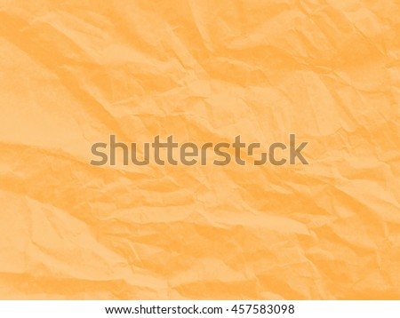 Art paper texture. Unique crumpled soft orange color of paper sheet for background.