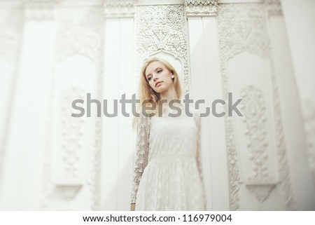 Art photo of a beautiful young bride with shallow DOF - stock photo