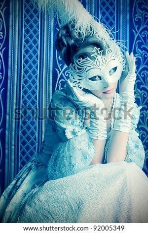 Art portrait of a beautiful female model in a snowy mask. Christmas. - stock photo