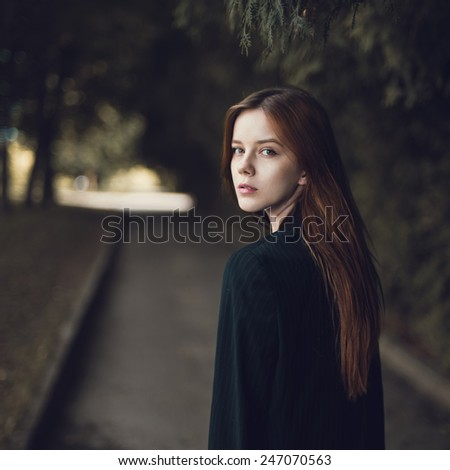 Art portrait of a beautiful girl in the park