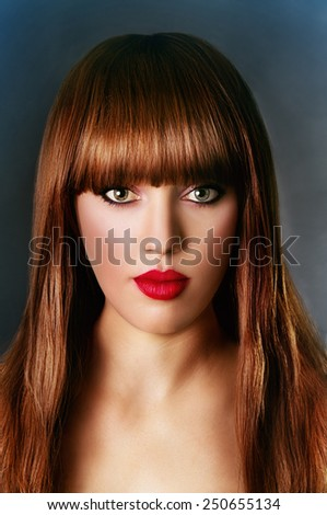 Art portrait of a beautiful girl on a black background - stock photo