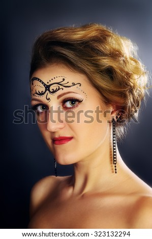 Art portrait of a girl with a pattern on the face - stock photo