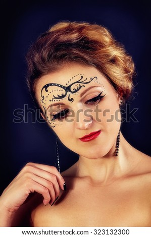 Art portrait of a girl with a pattern on the face in studio - stock photo