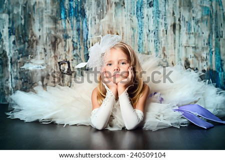 Art portrait of a pretty little girl wearing princess dress. Fashion shot. Childhood. - stock photo
