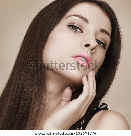 Art portrait of sexy woman with hot look holding hand near lips - stock photo