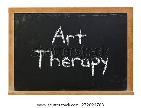 Art Therapy written in white chalk on a black chalkboard isolated on white  - stock photo