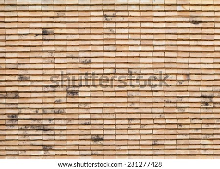 Art tile roof at Thai temple for background - stock photo