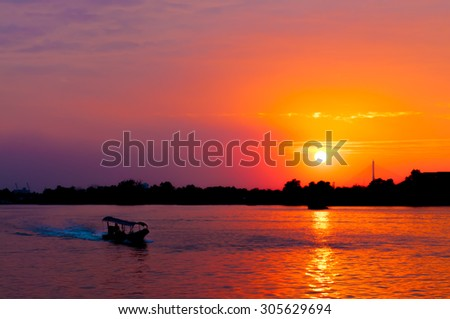 art tone,soft focus and silhouette a boat on the lake with sundown time background - stock photo