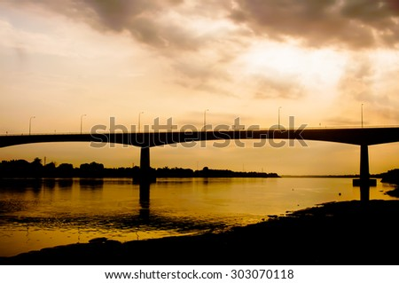 art tone,soft focus and silhouette bridge on orange sunset background