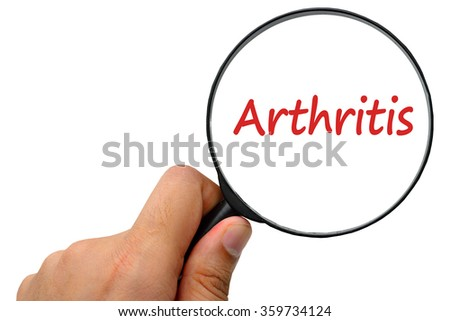 Arthritis word. Magnifier and puzzles. - stock photo