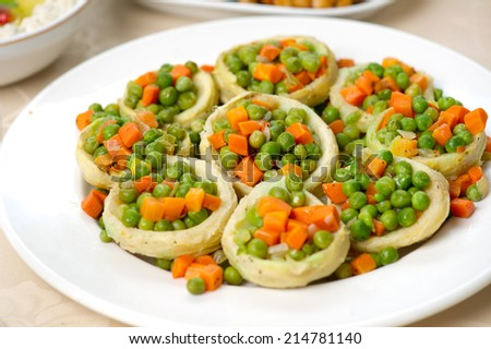Artichoke hearts stuffed with vegetables  - stock photo