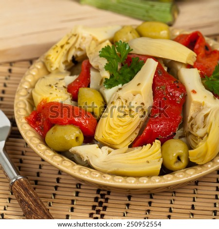 Artichoke, Olive, and Roasted Pepper Antipasto. Selective focus. - stock photo