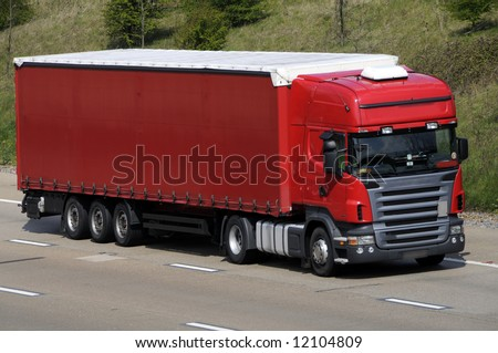 Articulated lorry and trailer traveling on UK motorway