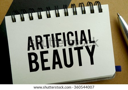 Artificial beauty memo written on a notebook with pen