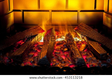 Artificial electronic fireplace, fire close up view - stock photo