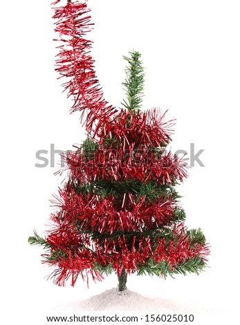 Artificial fir with red tinsel. Close up. Isolated on a white background. - stock photo