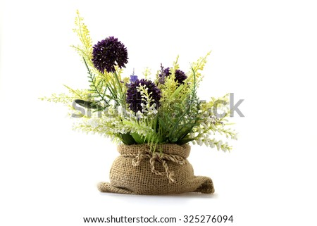 Artificial flower and plants in the sack. - stock photo