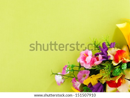 artificial flower arrangement on a yellow background with blank  for advertisement
