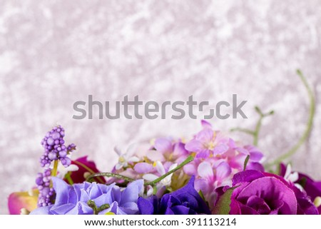 artificial flower bouquet on blurred light grey velvet background. selective focused with copy space. - stock photo