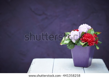 Artificial flower in pot - stock photo