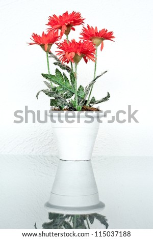 Artificial flower in vase  on table - stock photo