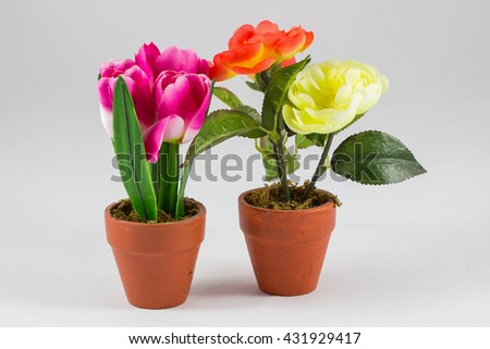 artificial flower pot on white background / plastic flowers on white background